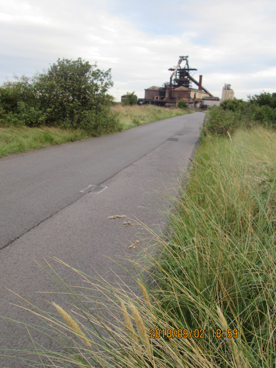 Away to the west, the now defunct Warrenby steel plant stands idle beside the road to Coatham and Redcar...
