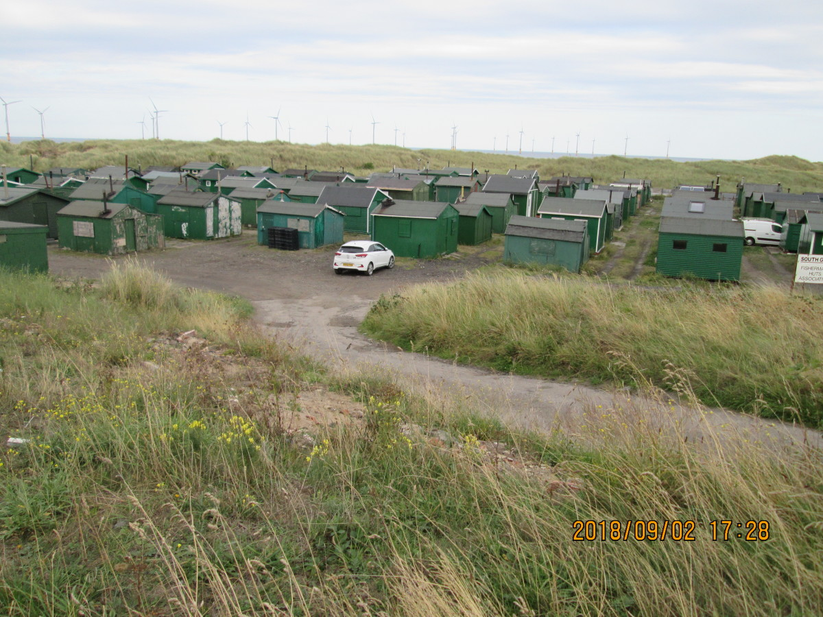 Across the causeway, on the south side of the gare in a dip is this ordered concentration of fishermen's huts