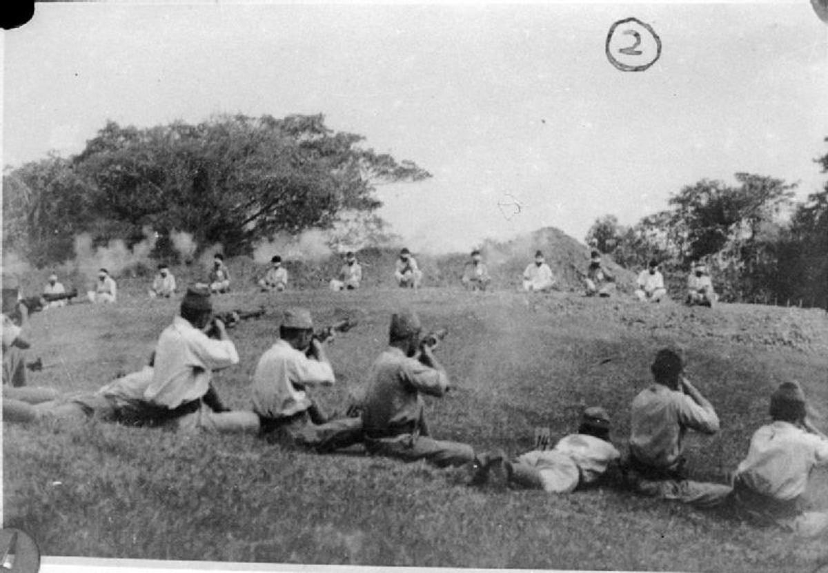 Japanese soldiers shooting dead a number of Sikh prisoners that had served with the British.
