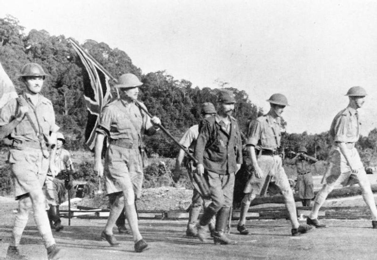 Lt. General Arthur Percival (carrying the Union flag) and his party on their way to surrender to the Japanese.