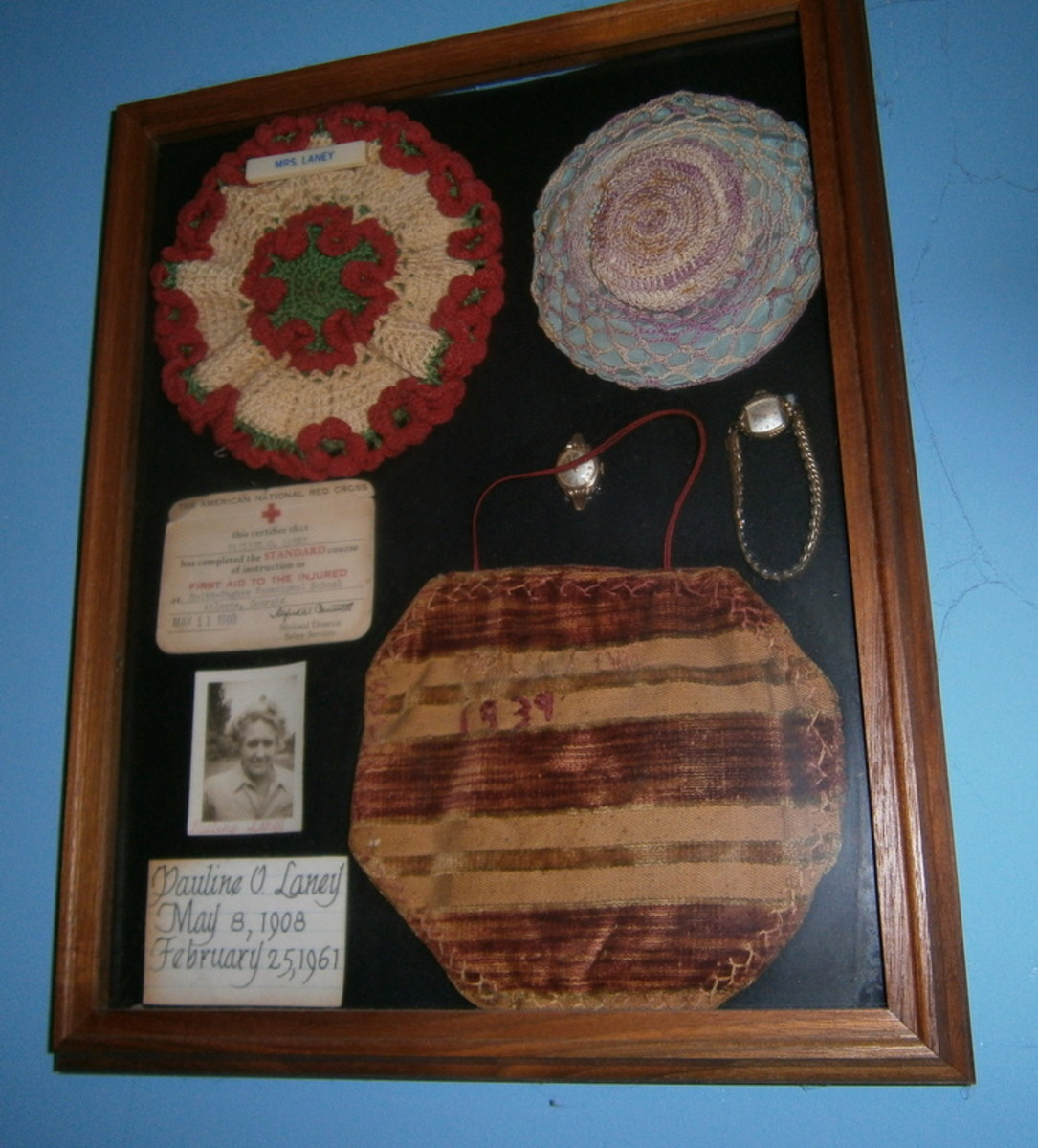 These are pin cushions my Mother made.  One is dated 1939.  The watch she wore is here, and a photo of her.