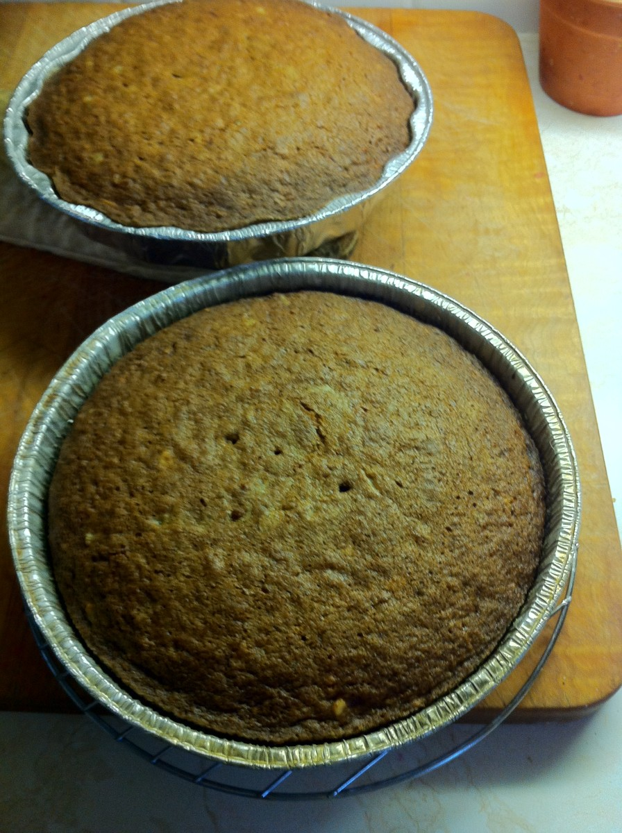 cakes are now ready to be transferred onto a rack to cool before frosting.