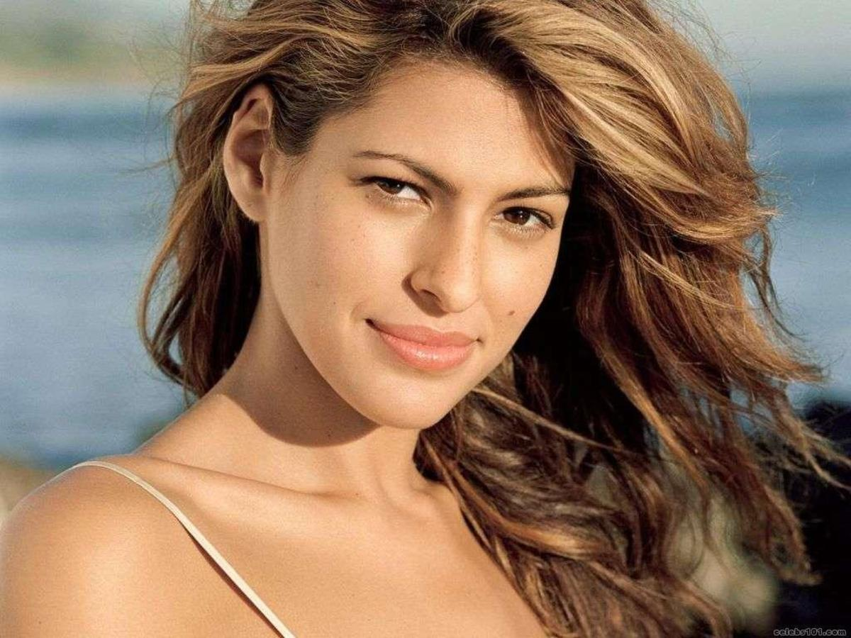 Eva Mendes with olive skin, blonde hair, and brown eyes.