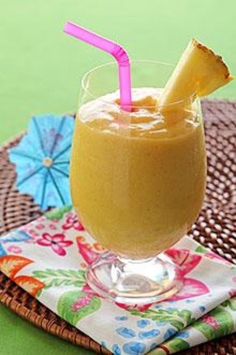 Here you have a delicious Banana Mango Smoothie that also has pineapple juice and a piece of pineapple for a garnish.