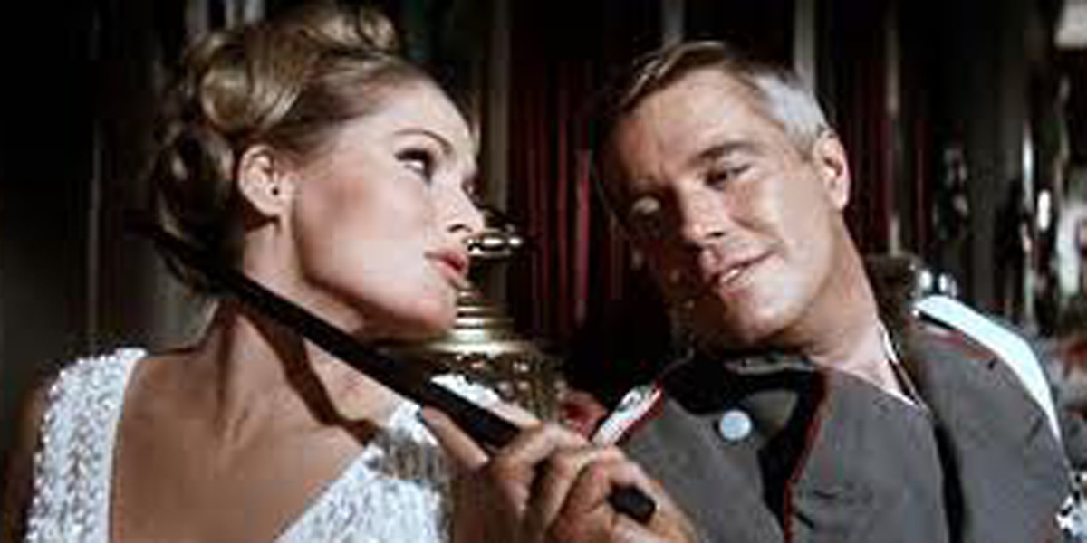 Ursula Andress and George Peppard indulge  in a complex and fateful relationship