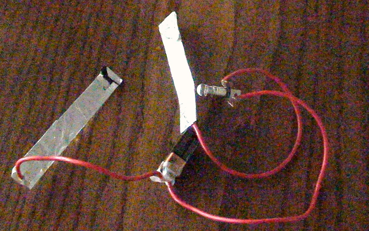 Attach the the stripped end of the third copper wire to the light bulb and socket.  Attach the other stripped end of the wire to the second electrode.  Your salt water circuit is ready to use.