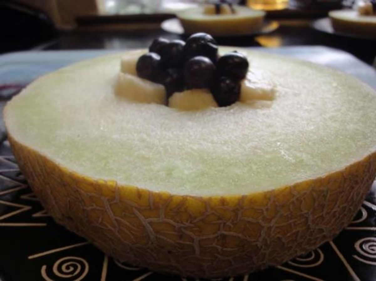 Melon stuffed with banana and bluberries