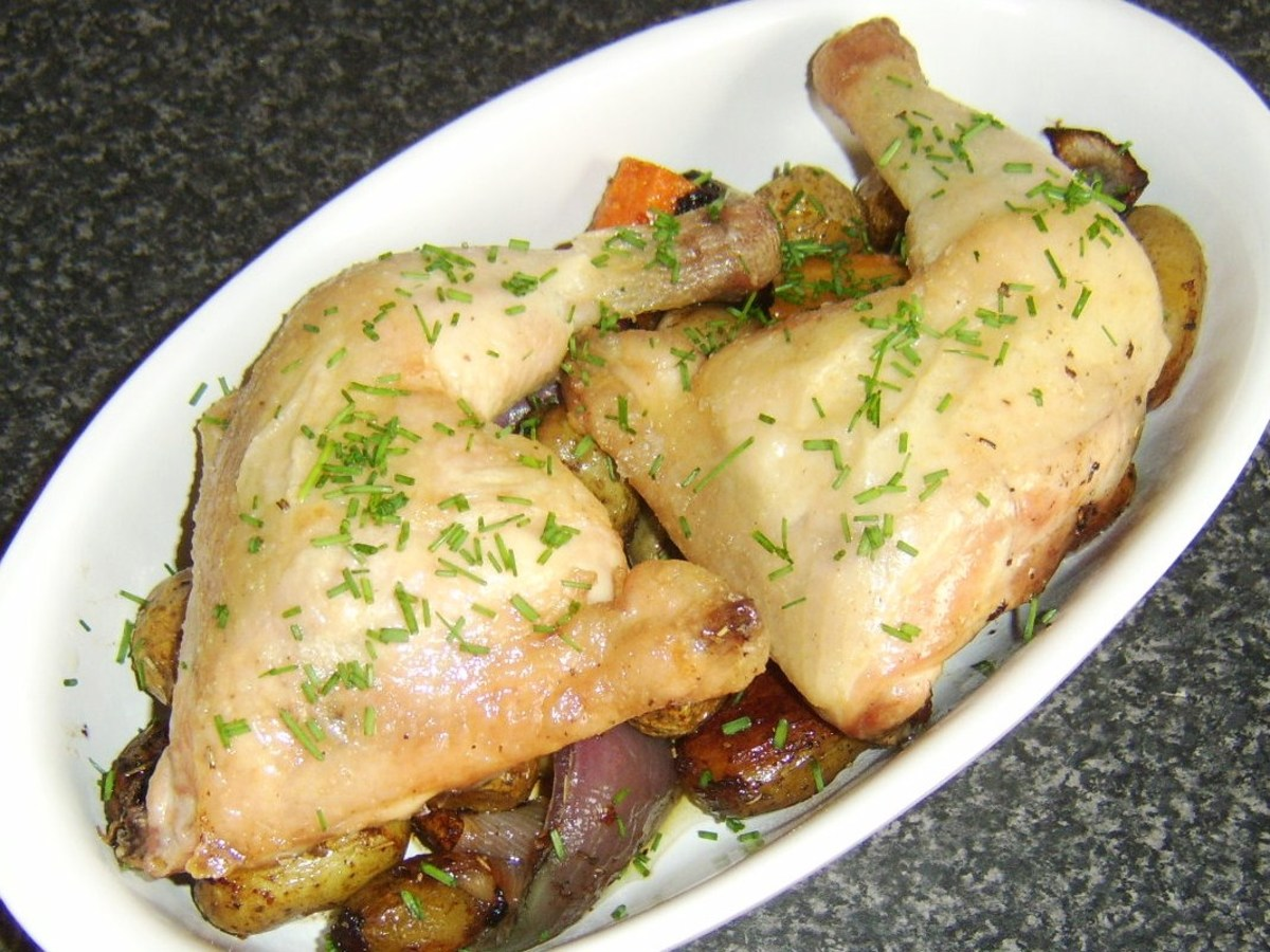 Whole chicken legs are roasted on and served with mixed root vegetables