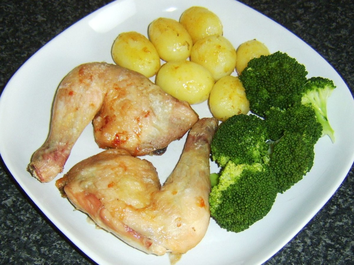 Succulent and tender chicken legs beyond belief (confit) are served with potatoes roasted in goose fat and broccoli