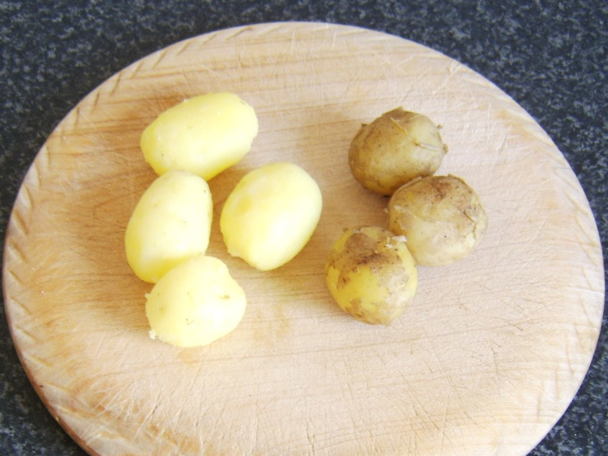 Peeling cooked and cooled potatoes for roasting