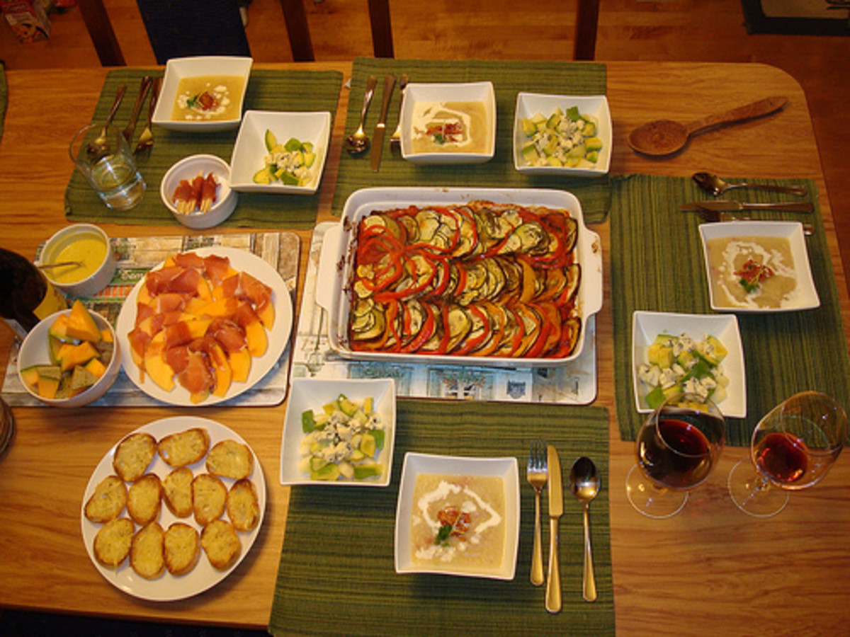 Ratatouille as a main dish, surrounded by side dishes and dipping sauces.