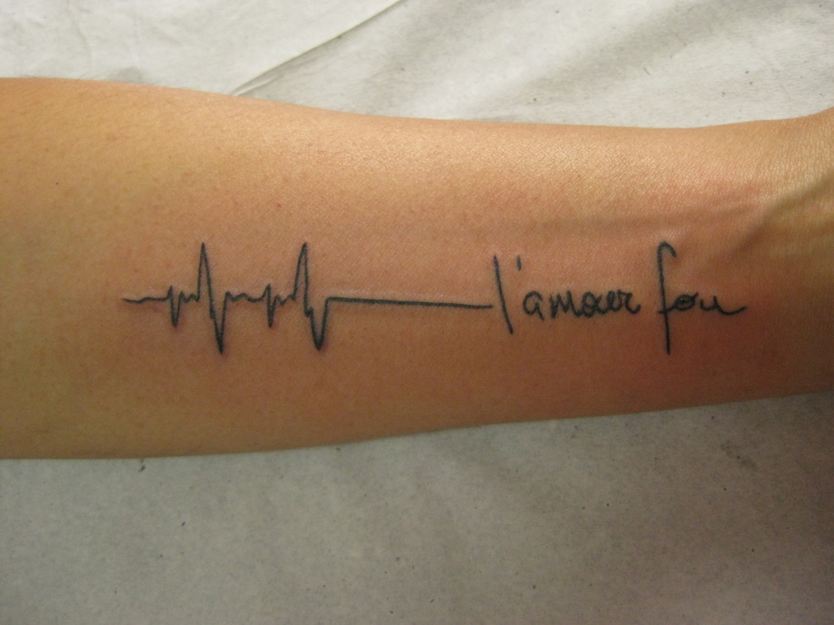 heartbeat or ekg line tattoo designs and meanings hubpages. Black Bedroom Furniture Sets. Home Design Ideas