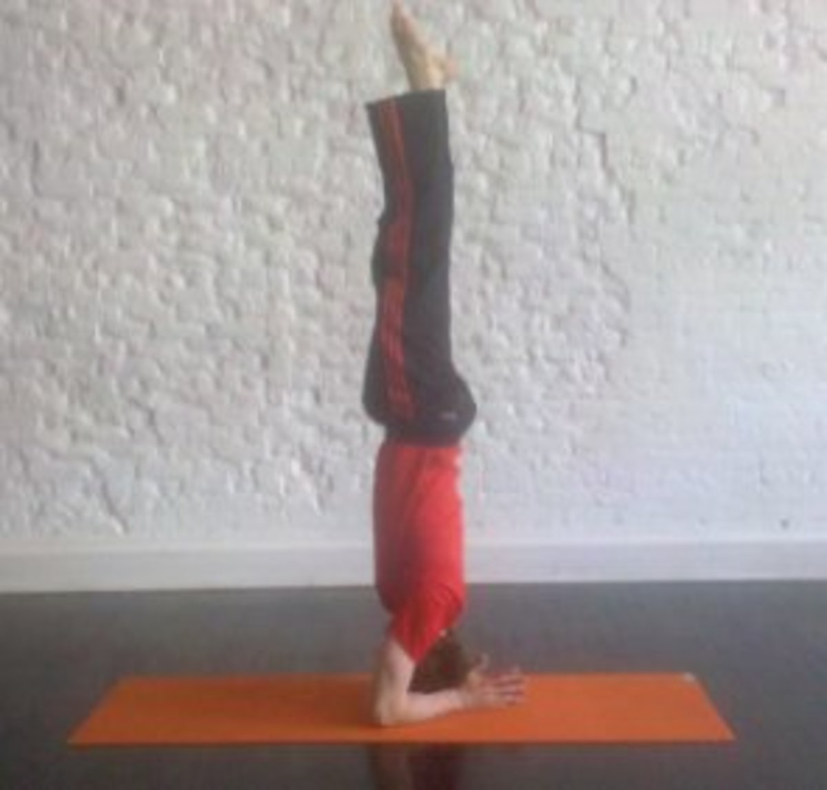 Inversion therapy with headstand.