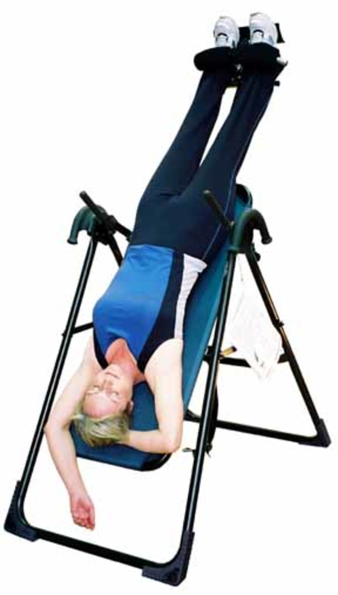 Inversion therapy with an inversion table.