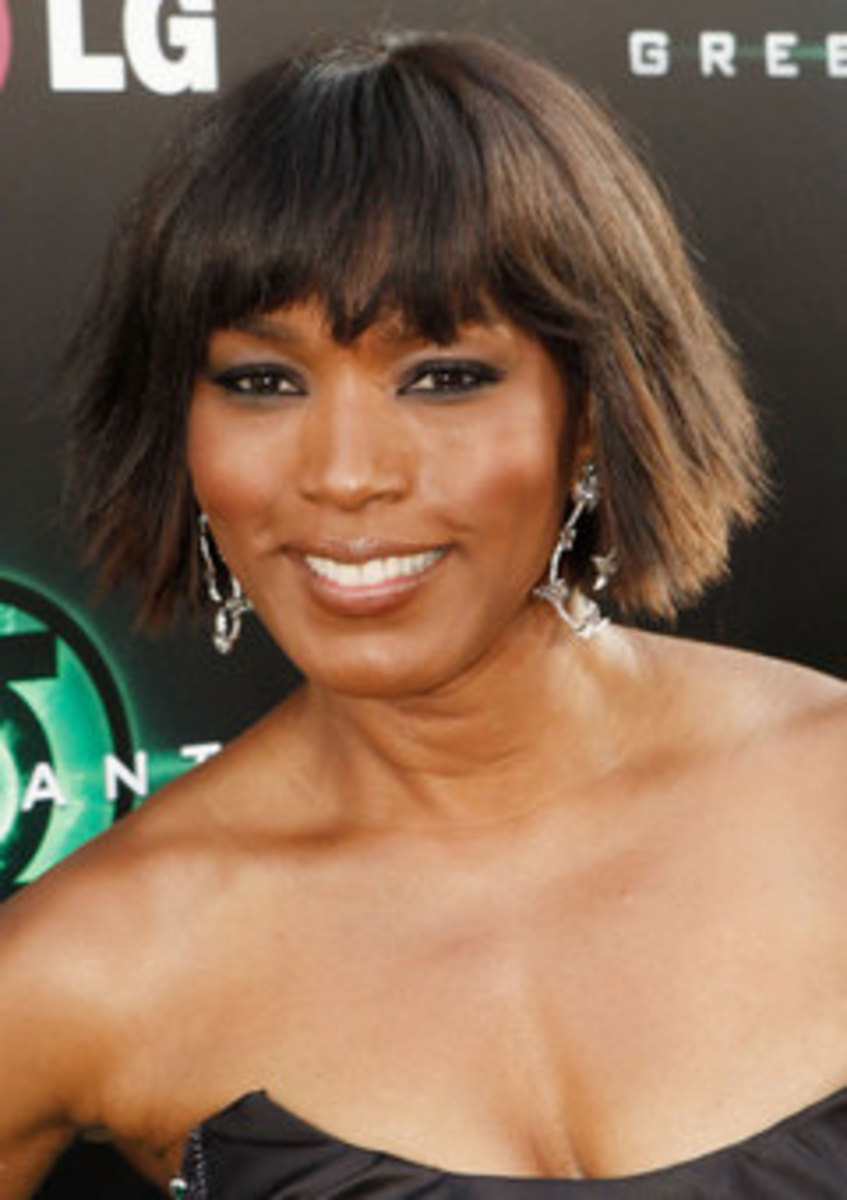 Angela Bassett in a Razor-cut Bob with Soft Bangs. Bob Haircuts for Black Women.
