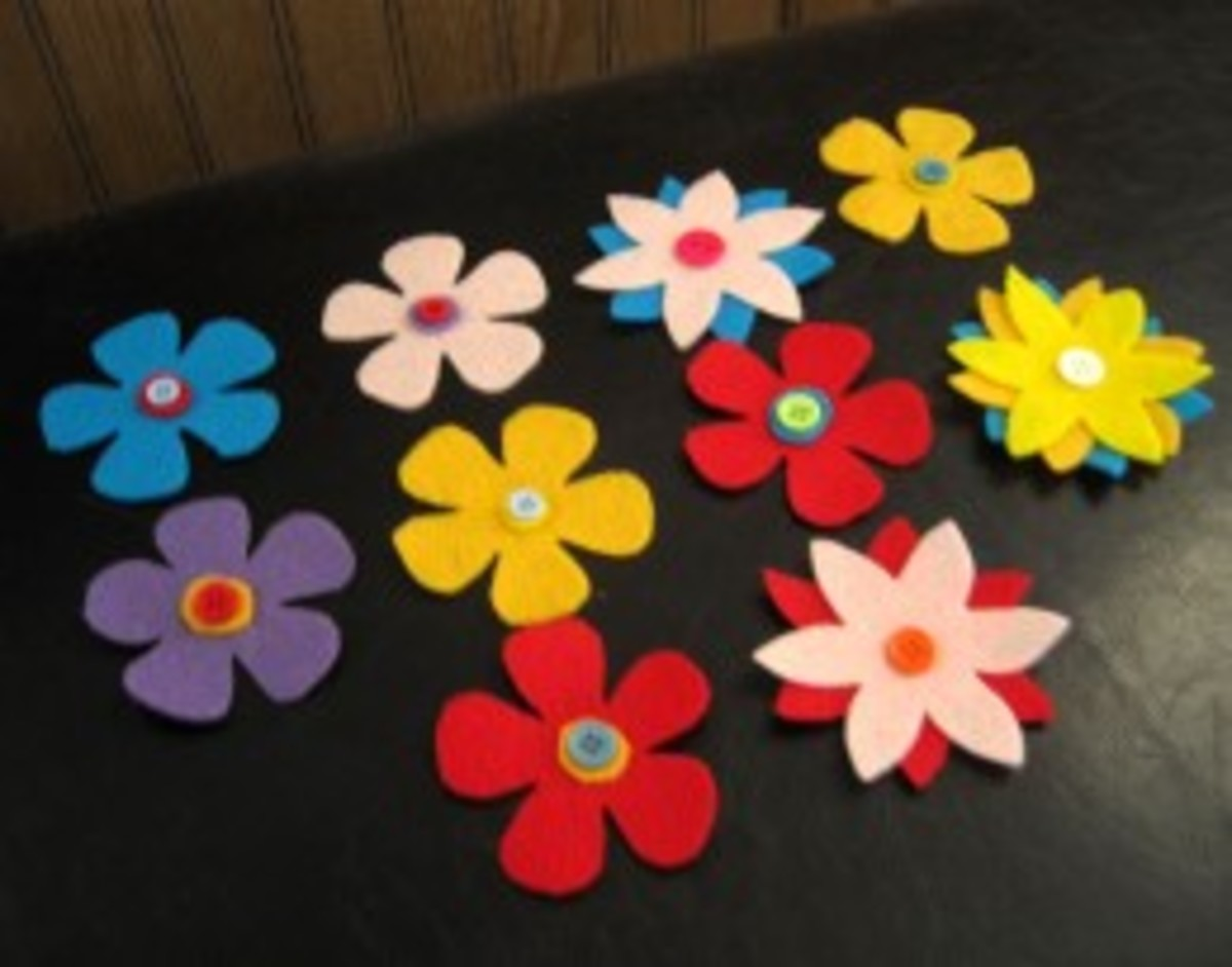 I love to make flowers out of felt and buttons.