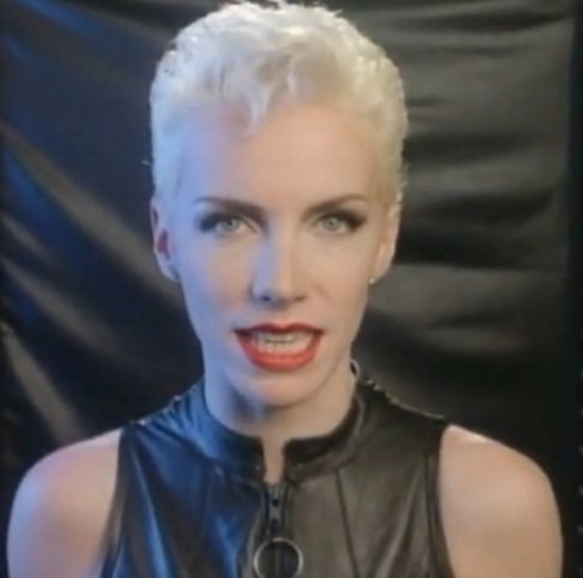 Annie Lennox in closely cropped blonde hair and full makeup. Pixie haircut gallery.