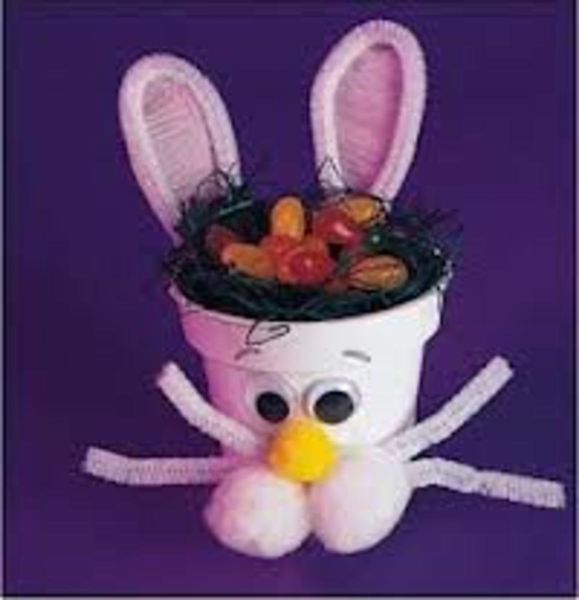 BUNNY FLOWER POT FOR EASTER - SIMPLY ADD POM-POMS, PIPE-CLEANERS, AND GOOGLE EYES.  (THERE IS ALSO A WHITE POM-POM COTTON-TAIL, IN THE BACK)!
