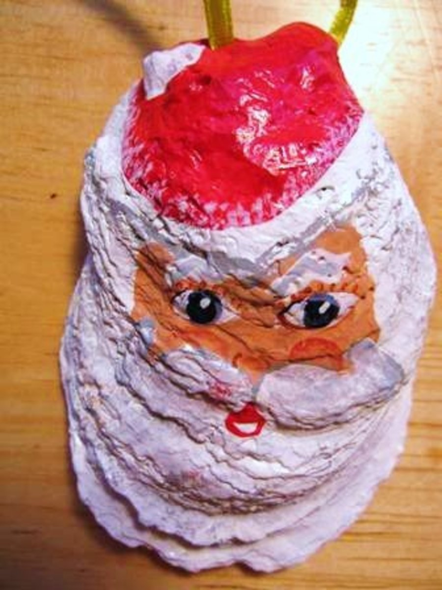 To make a fancy ornament, you can glue white cotton to the face for a beard, eyebrows, and hair or a ball on Santa's hat.
