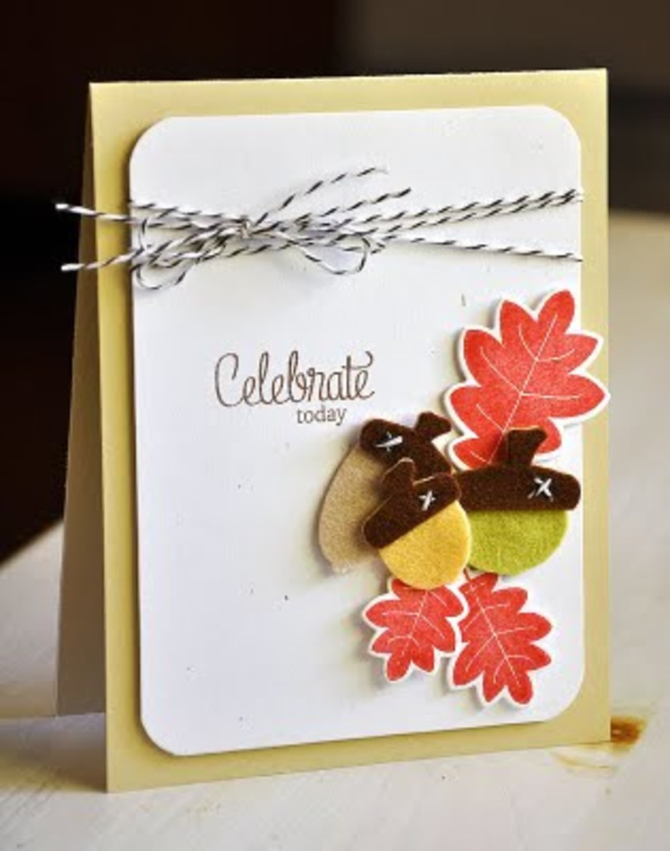 I love how Mailles mixed paper and felt embellishments, finished with a ribbon to add even more texture.