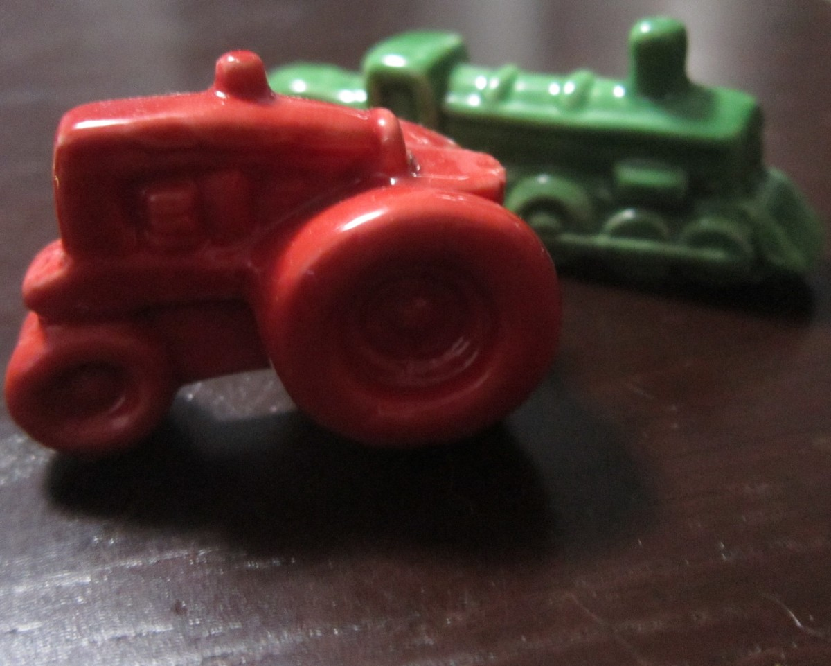 """A tractor and a train, from the """"American Heritage"""" series of Wade figurines."""