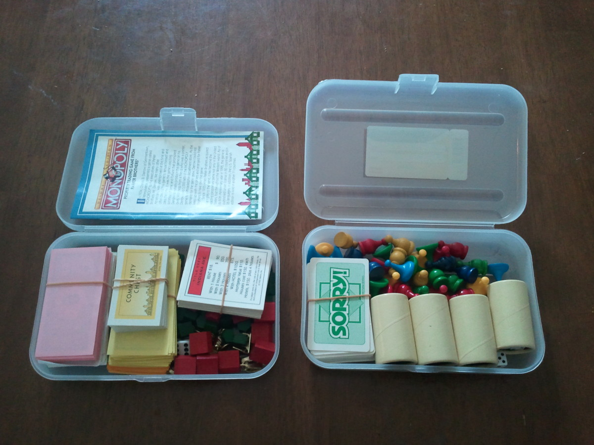 Placing the games pieces, money, cards, dice etc. into the pencil boxes to save space. The box on the left contains all the pieces etc. for the game of Monopoly and the one on the right contains the pieces for both Parcheesi AND Sorry.