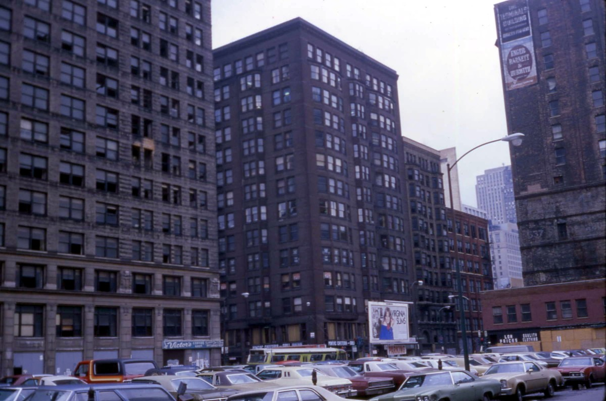 Vacant Transportation Building (far left) in 1978, with missing windows.