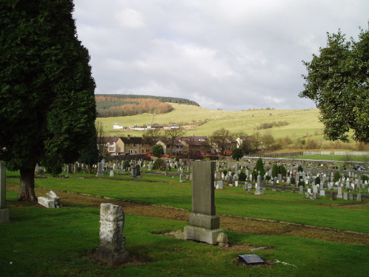 Ballingry cemetery to the East of Benarty Hill - seen in the background on the left of the photograph -  Some of the graves go back hundreds of years.