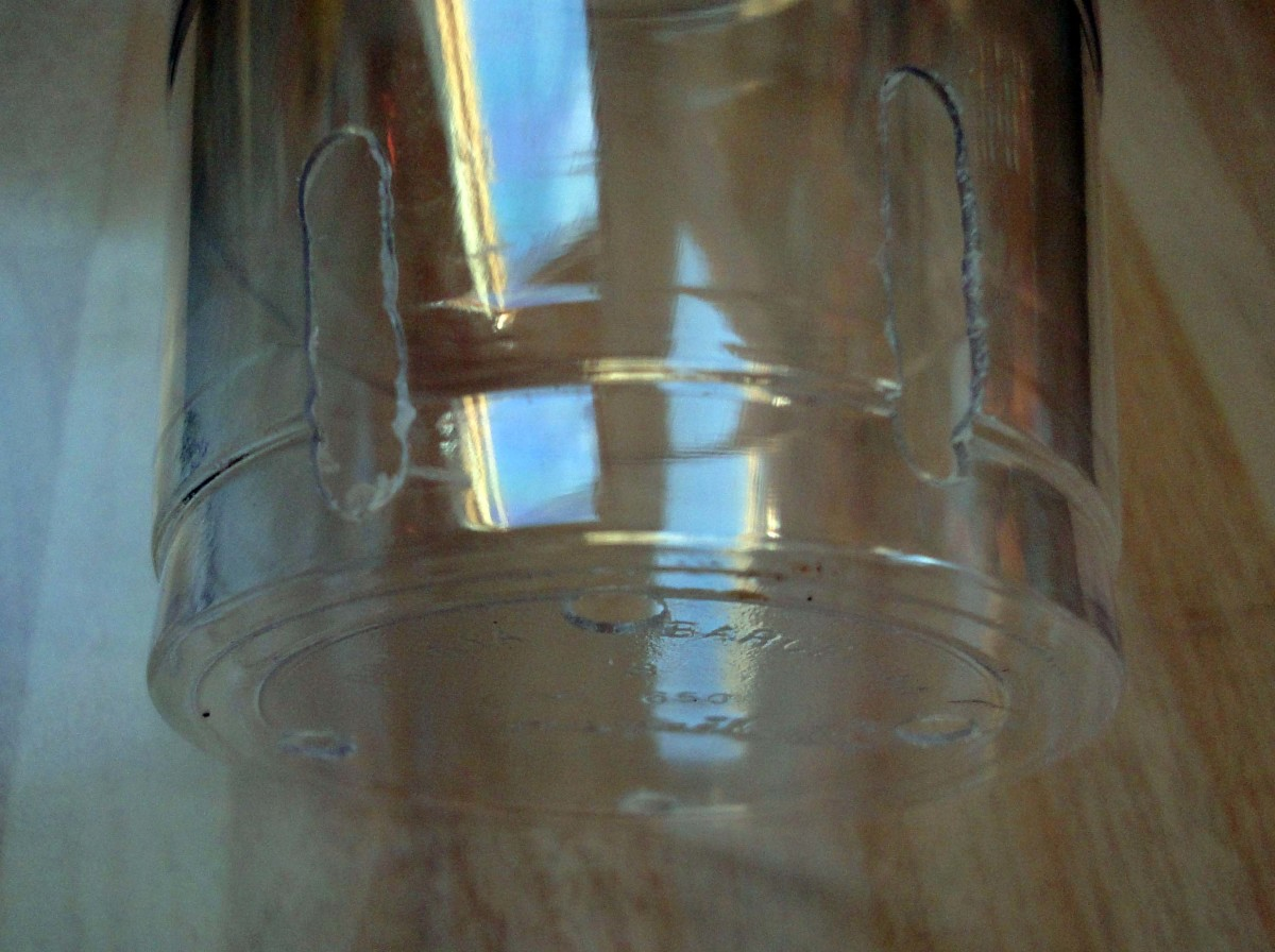Making drainage slits in the side of a plastic cup with the Dremel