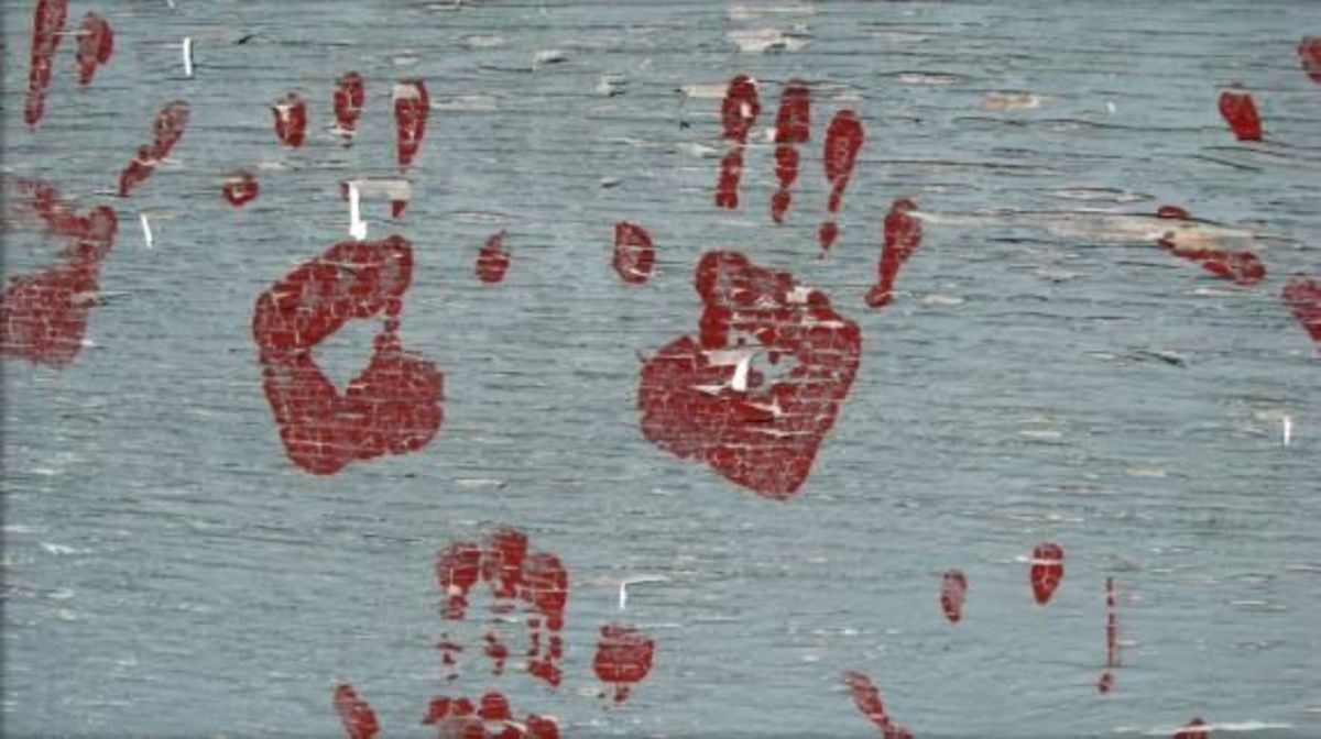 Old hand prints on a dugout