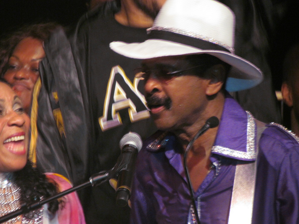 """After a wardrobe change Larry returns in purple as he royally sang his powerful hit, """"One In A Million."""""""