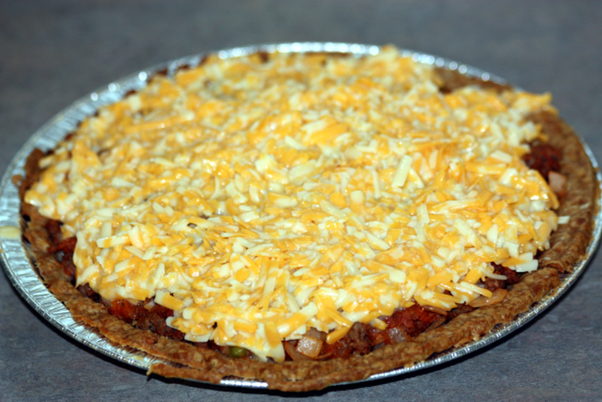 Top with grated cheese mixture.