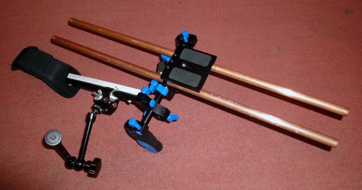 Shoulder Rig with camera plate and articulating arm and support clamp.