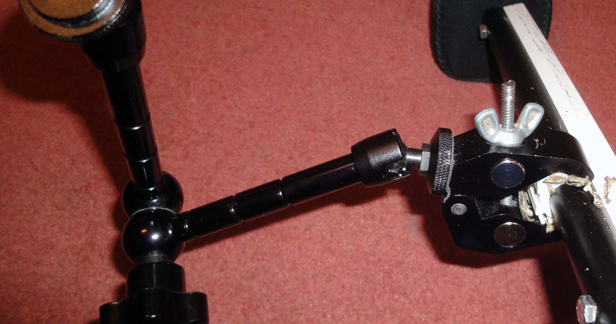 An 11 inch articulating magic arm and support clamp for attaching additional camera equipment e.g. 7 inch LCD.