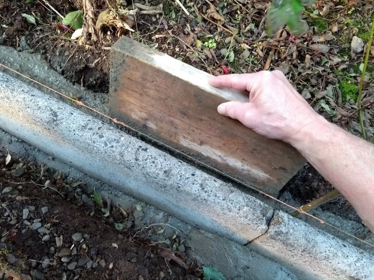 Pack the concrete with a short length of board.