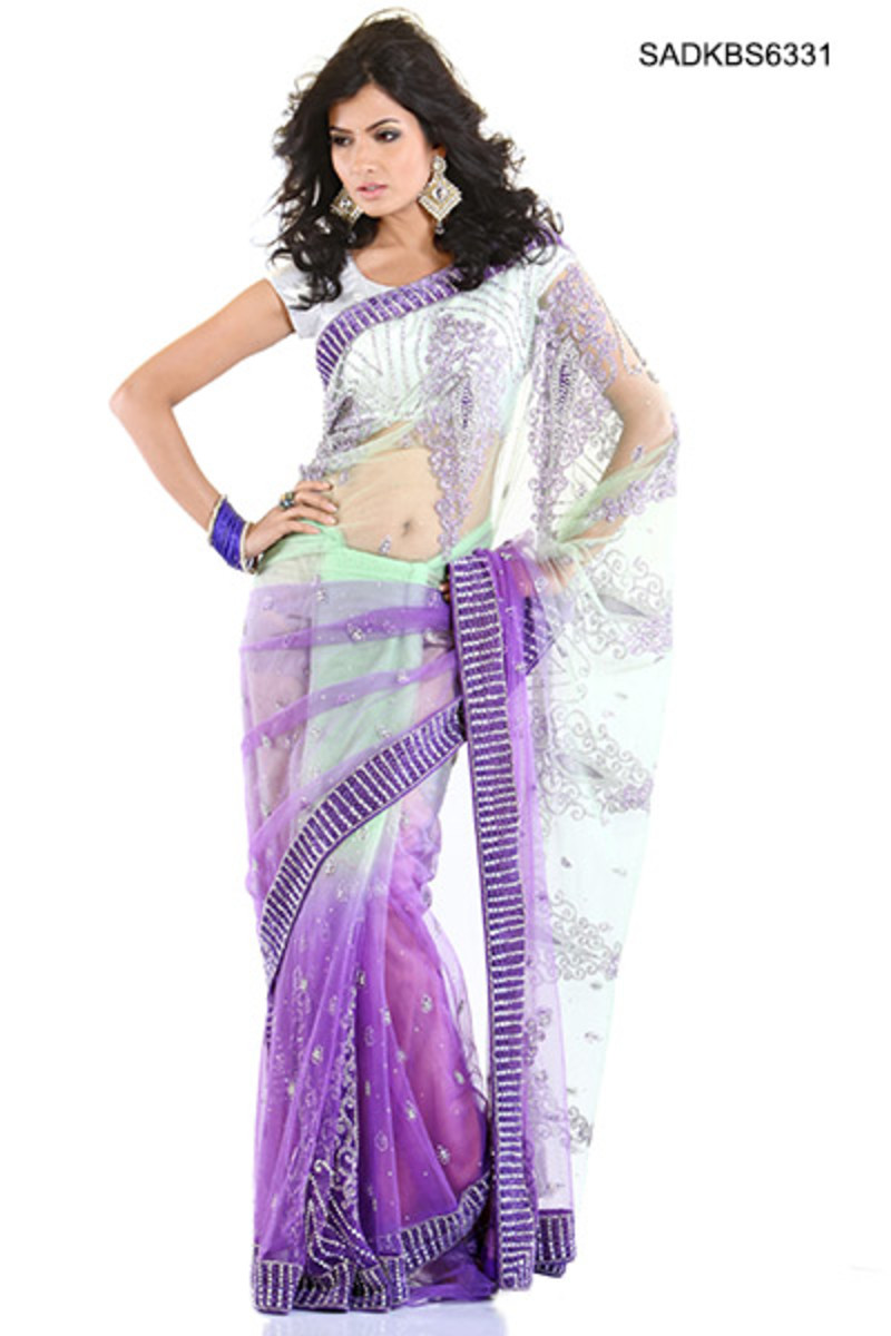 Admirable Stones Decked Net Saree. Photo courtesy of Cbazaar.com.