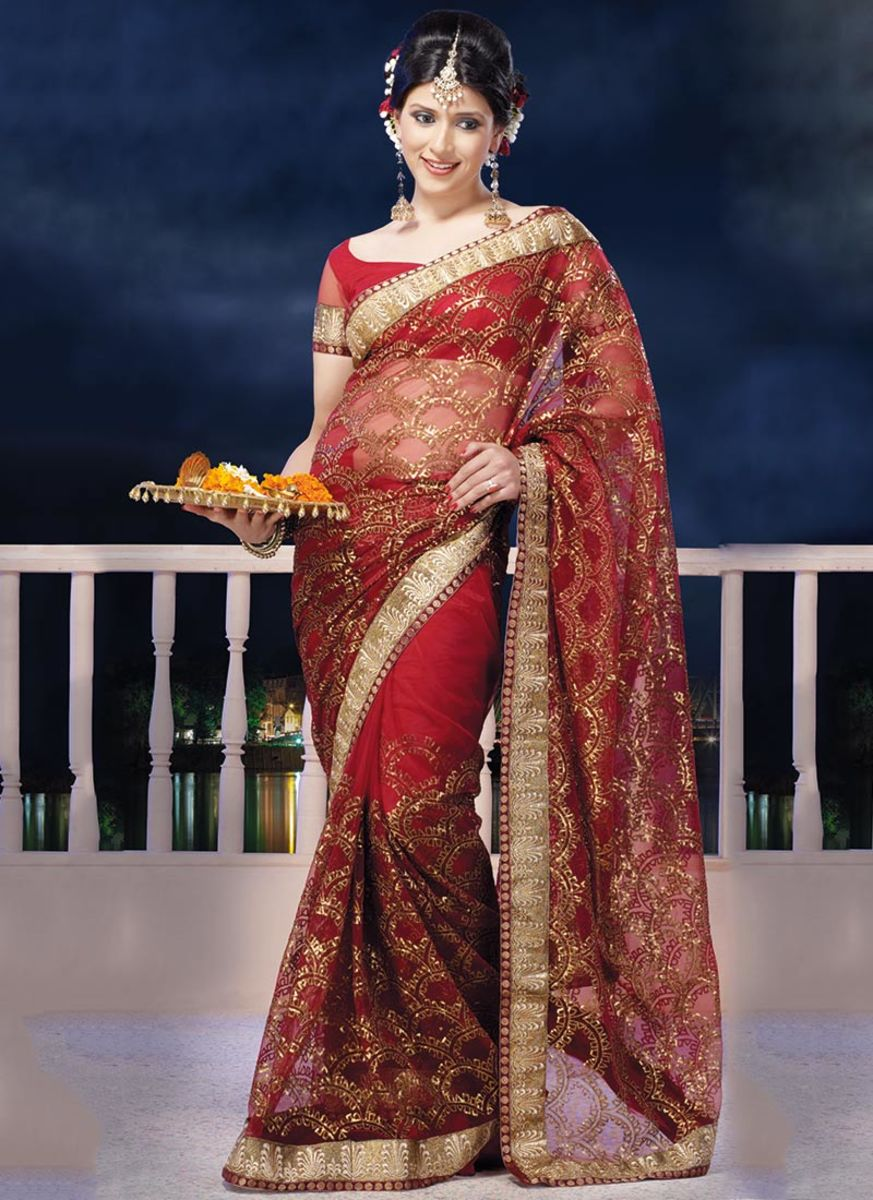 Beguiling Red Embroidered Net Saree. Photo courtesy of Cbazaar.com