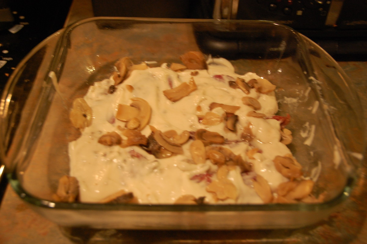 Loins covered with cream of mushroom soup and extra mushrooms, ready to go in the oven