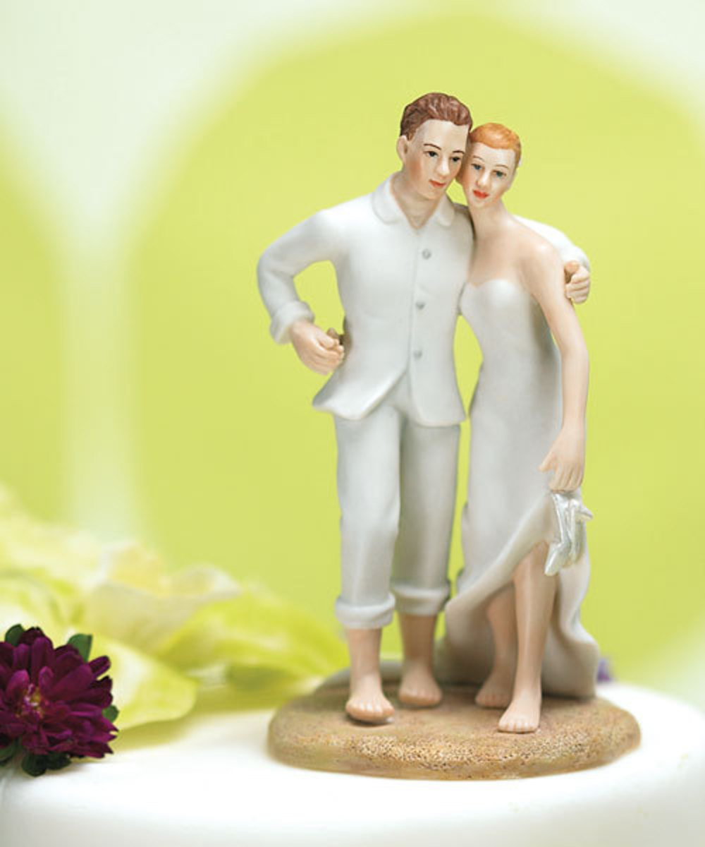 Posing couple beach wedding cake topper