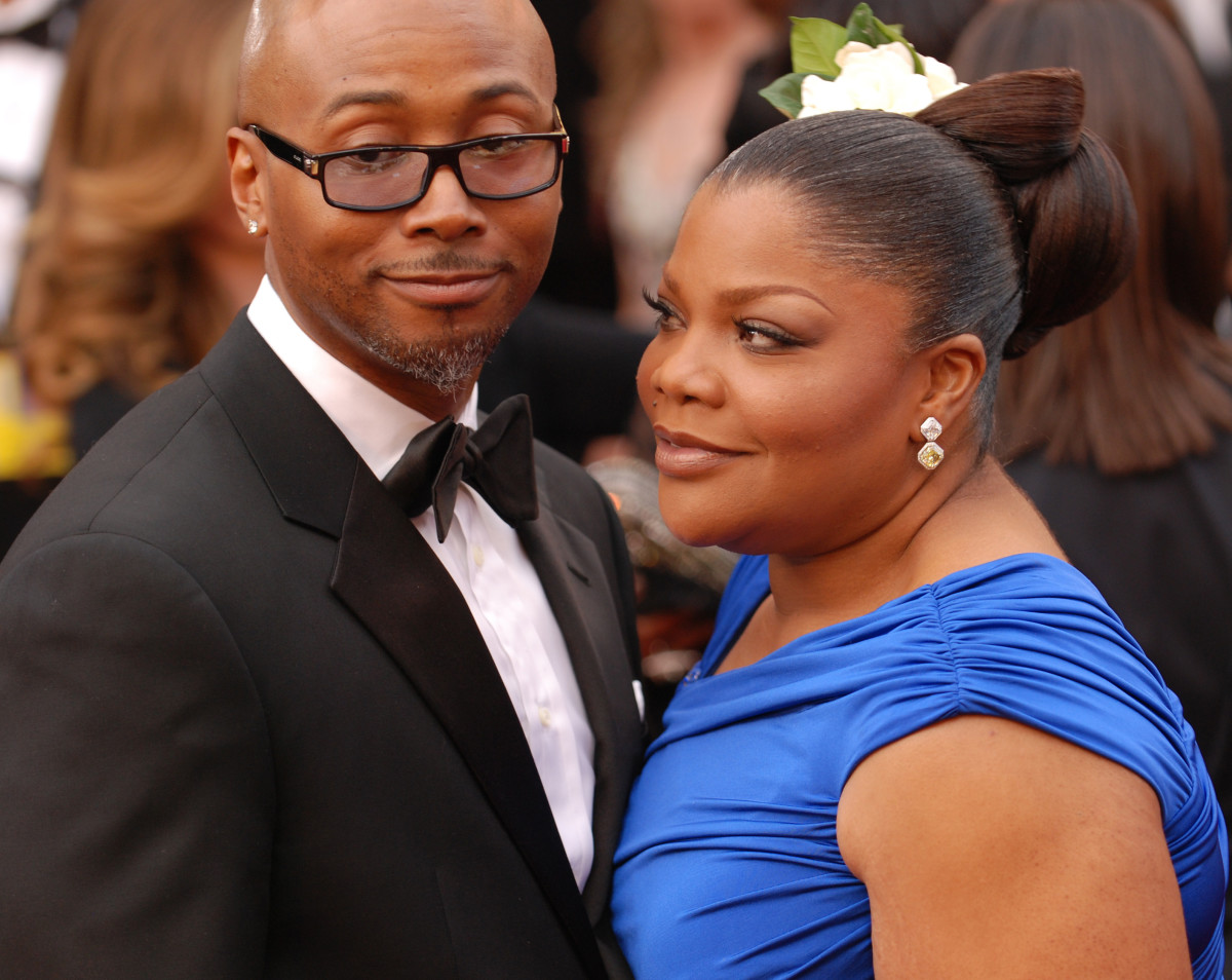 Plus-sized beauty and Oscar winning actress, Mo'Nique, with Husband Sidney Hicks enjoying a moment on the red carpet at the 82nd Academy Awards.