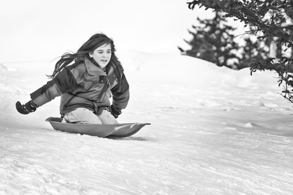 Sleds are a great winter photo prop for both kids and adults.