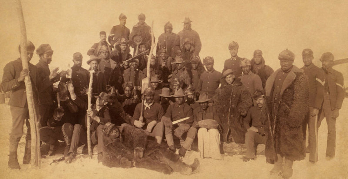 Buffalo soldiers of the 25th Infantry, some wearing buffalo robes, Ft. Keogh, Montana; 1890.