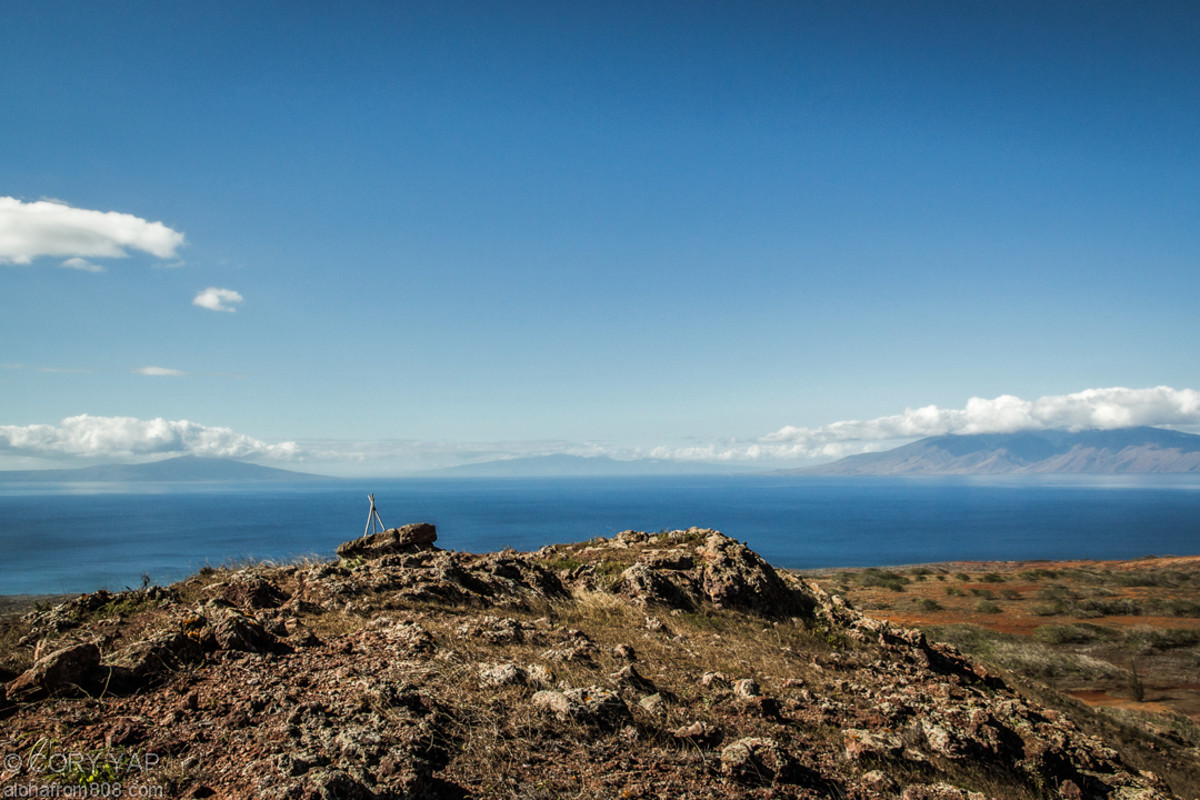 From a rocky hill on Kaho'olawe, Lanai and Maui are in the background.