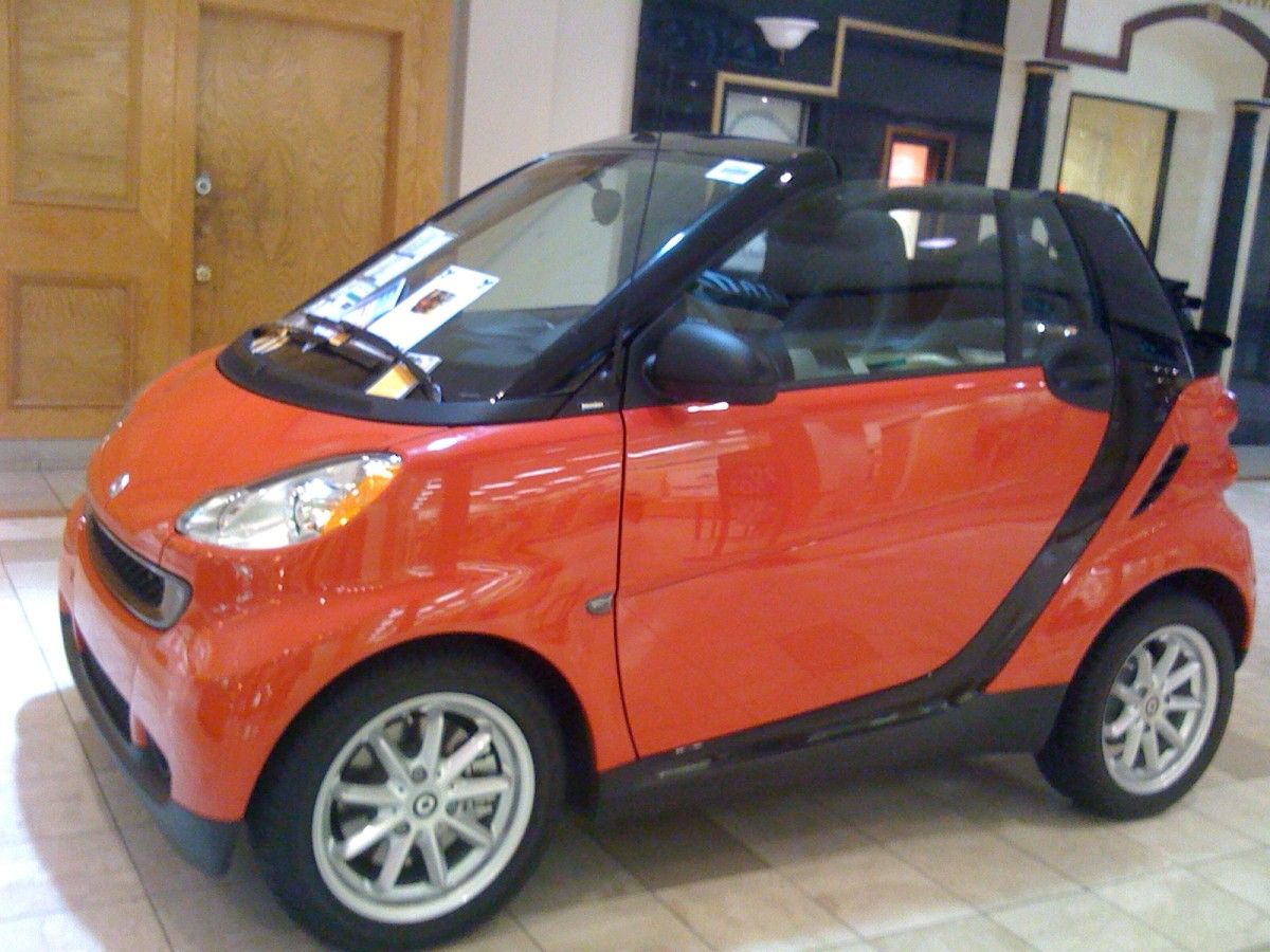 imagine the world's largest pumpkin weighs the same as this smart car!