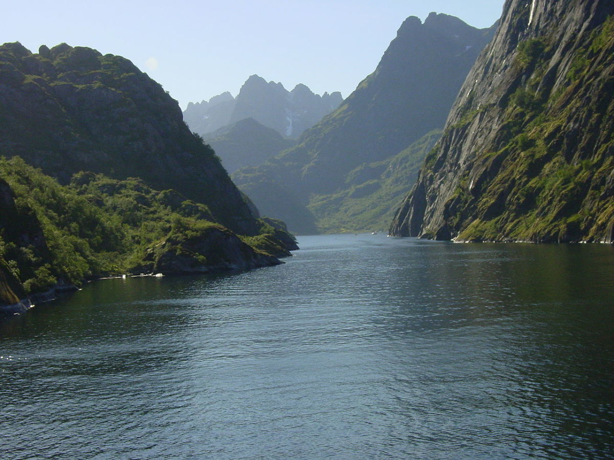 A secluded fjord in Norway surrounded by high cliffs and very protected