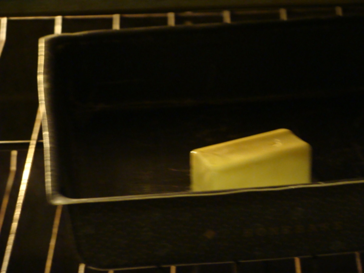 Melt your butter in your pan in your preheated oven.  Take out when melted.