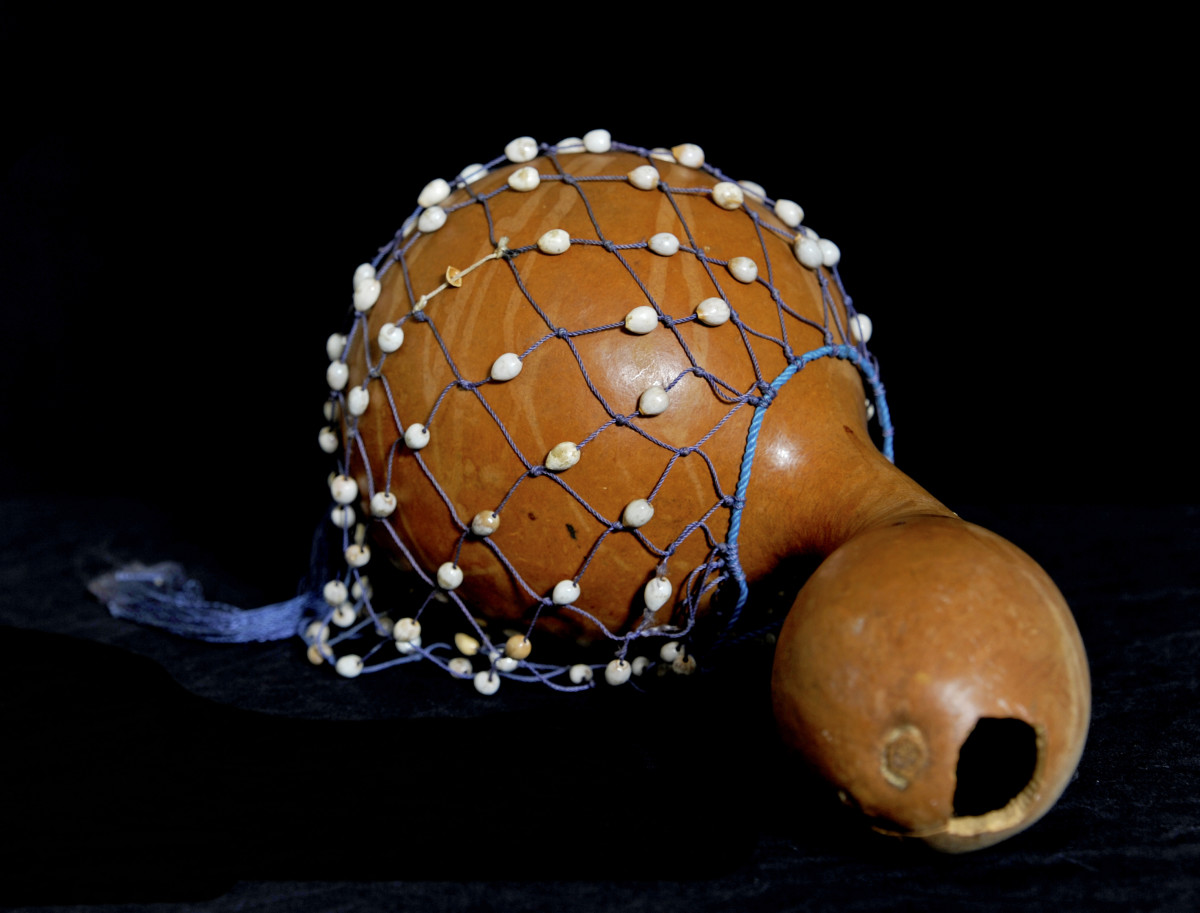 The Ghanaian beaded gourd instrument axatse.