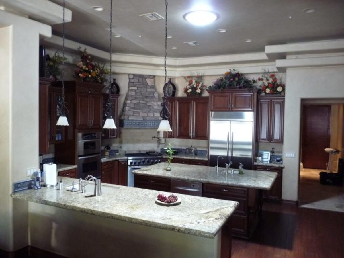 A kitchen before and after installing tubular skylights. What a difference!