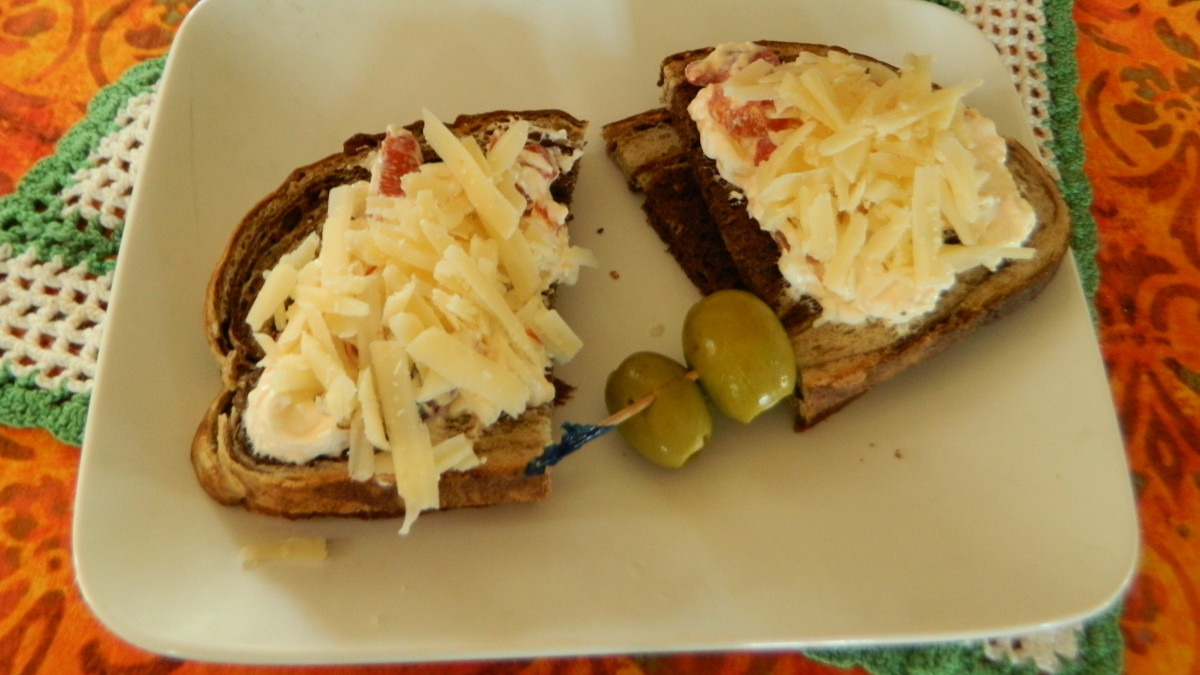 Veggie spread on marbled rye....topped with parm....is a combination that makes your tastebuds happy