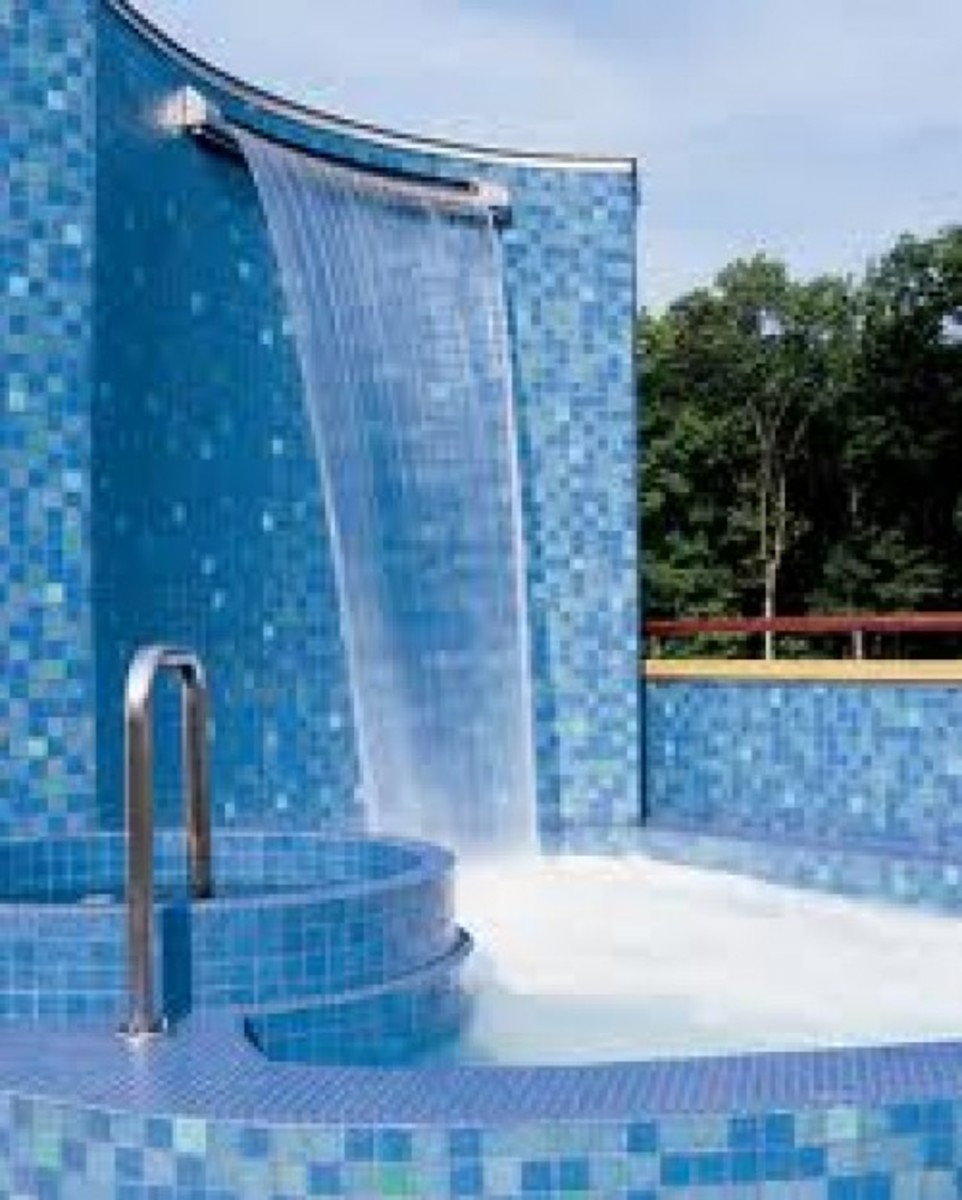 other swimming pool amenities such as an outdoor shower - this one is exceptional with its cascading water fountain and blue glass